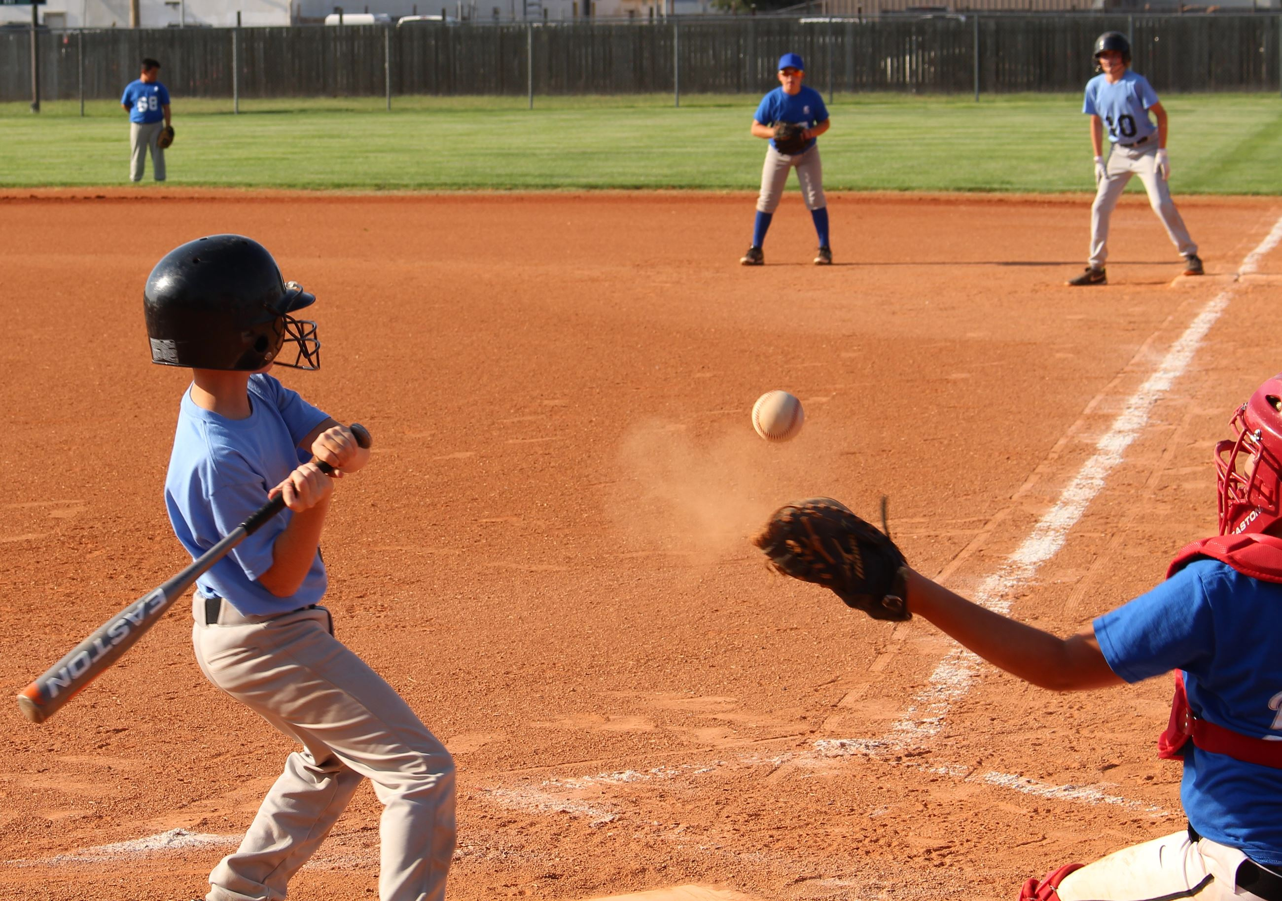Youth Baseball - Boy hitting the ball
