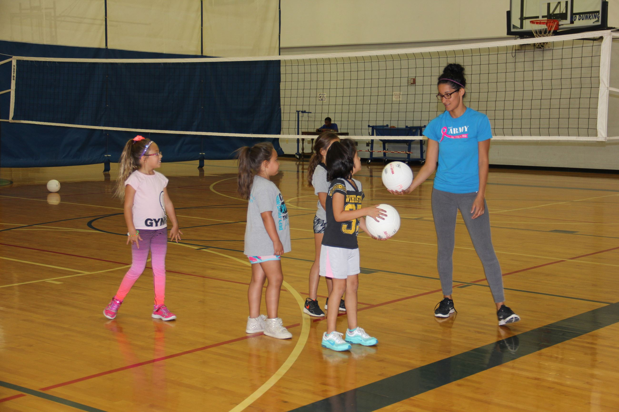 Youth Volleyball - girls practice serving