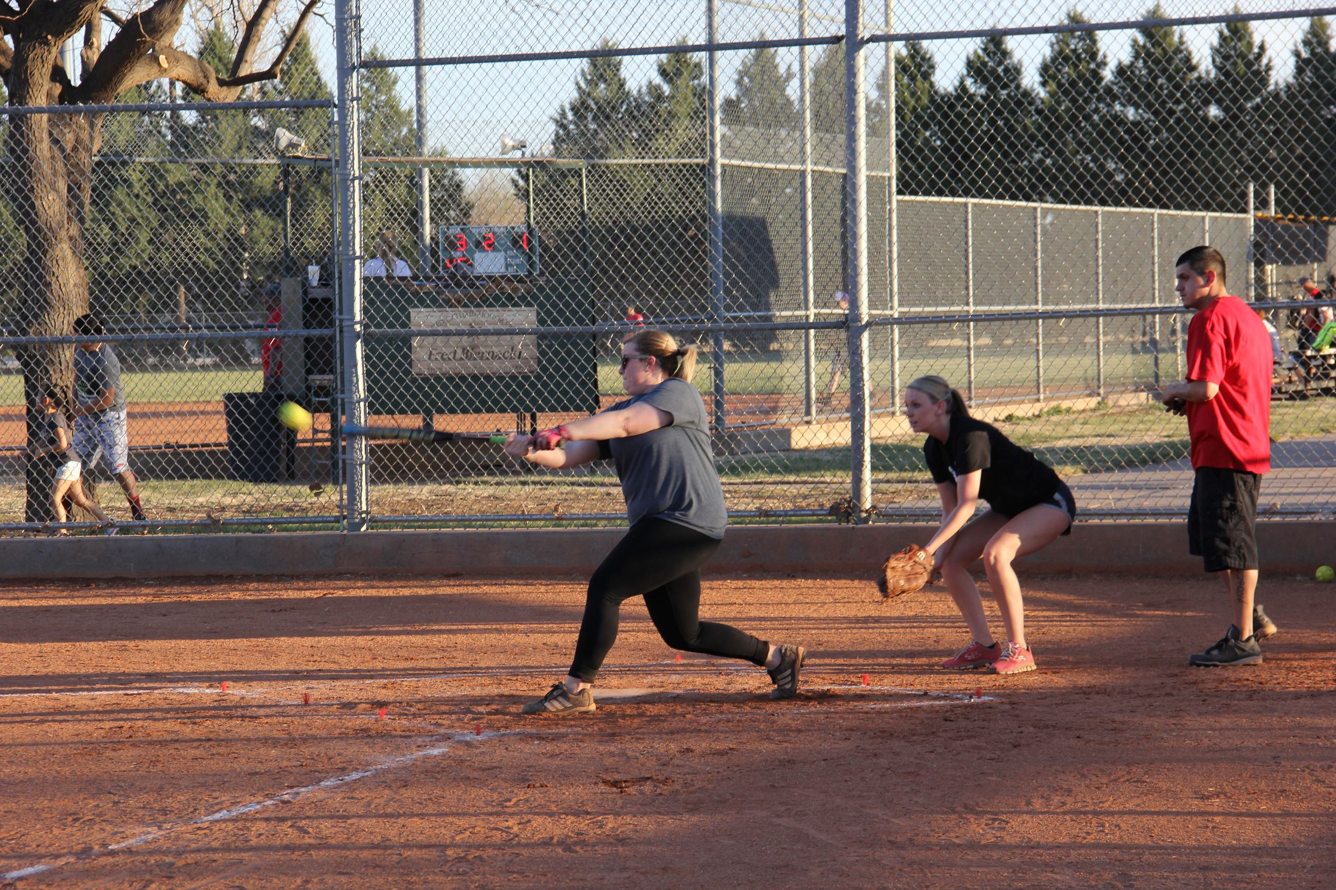 Woman up to bat in softball