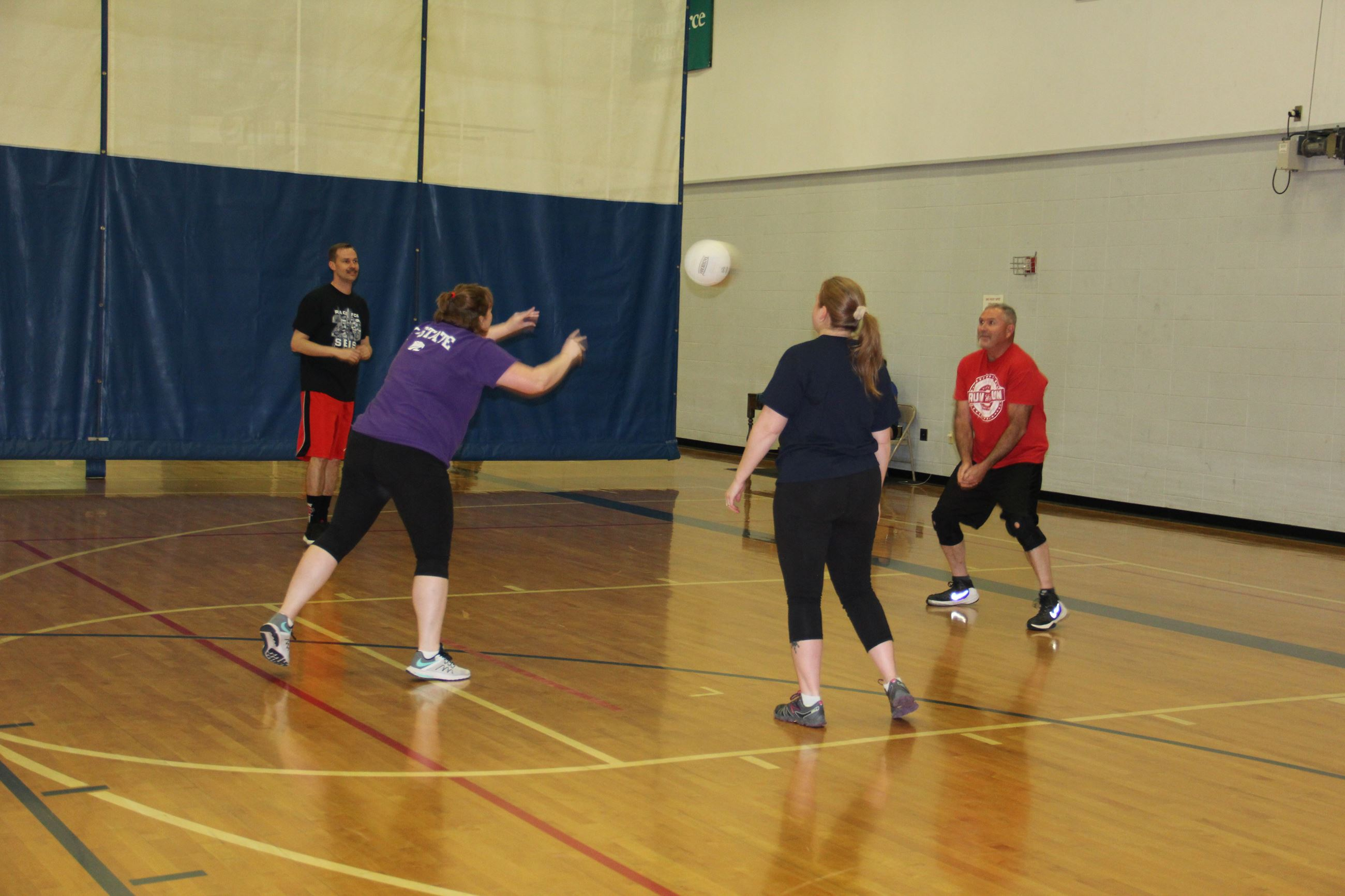 Coed team passing in volleyball