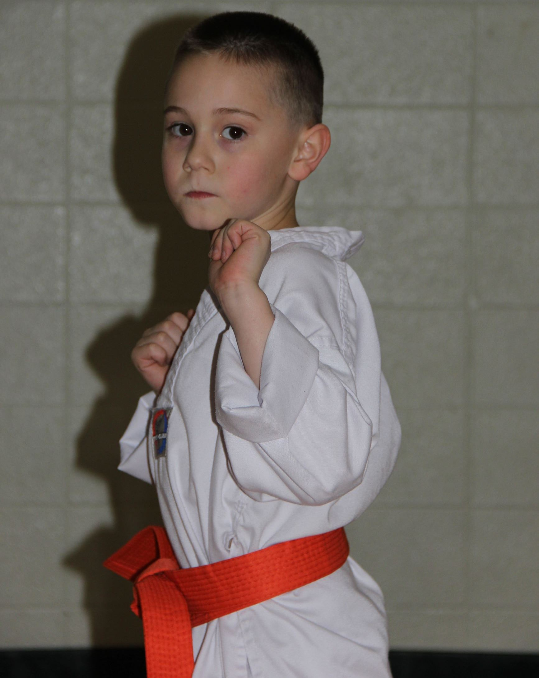 Little boy with orange belt