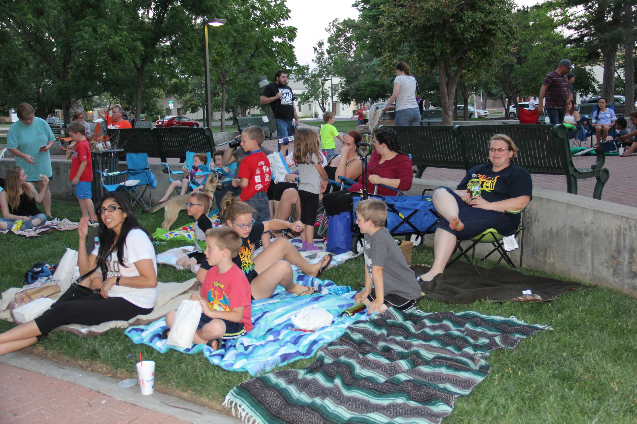 People gathered to watch movie in the park